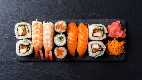 Overhead shot of Japanese sushi on black concrete background