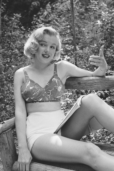 portrait of american actress marilyn monroe 1926   1962 at a photo shoot in griffith park, los angeles, california, august 1950 dressed in shorts and a bikini top, she sits on a wooden bench with an open script in her lap and mimes a scene photo by ed clarkthe life picture collection via getty images
