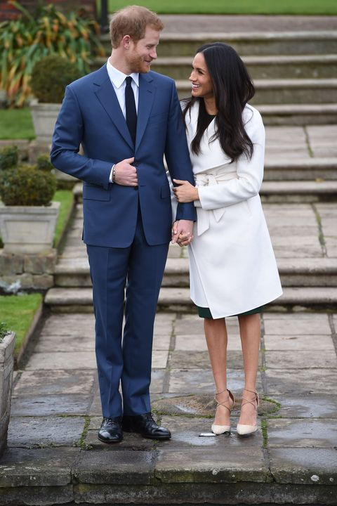 london, england   november 27  prince harry and actress meghan markle during an official photocall to announce their engagement at the sunken gardens at kensington palace on november 27, 2017 in london, england  prince harry and meghan markle have been a couple officially since november 2016 and are due to marry in spring 2018  photo by eddie mulholland wpa poolgetty images