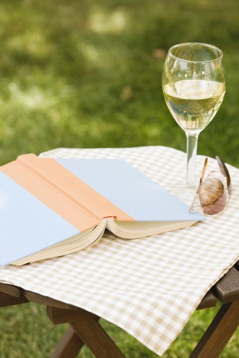Wine glass and book on outdoor table