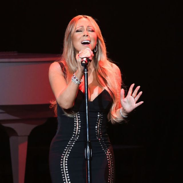 los angeles, ca   november 30  mariah carey performs onstage during the ahf world aids day concert and 30th anniversary celebration featuring mariah carey and dj khaled at the shrine auditorium on november 30, 2017 in los angeles, california  photo by tommaso boddigetty images for aids healthcare foundation