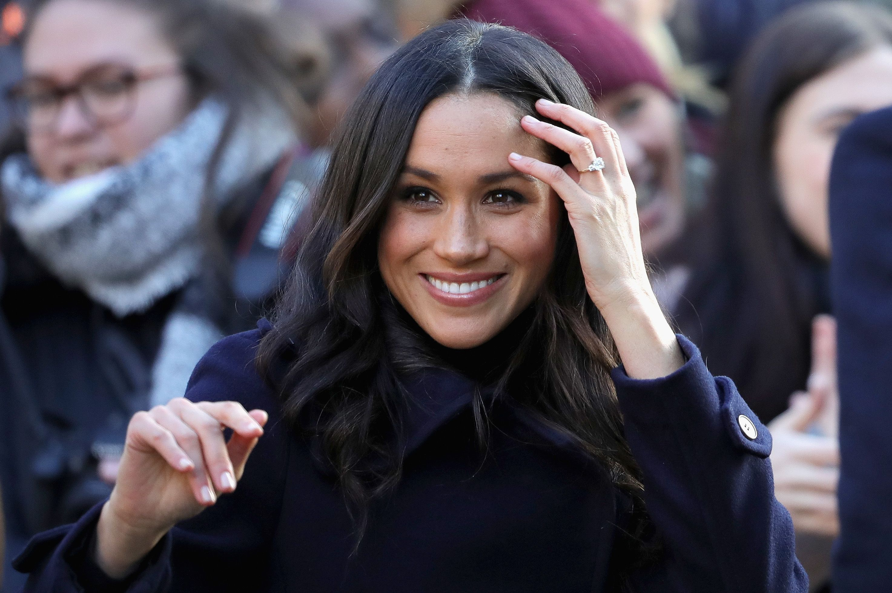 Meghan Markle Poses with Kate Middleton Tabloid Cover in Unearthed Photo