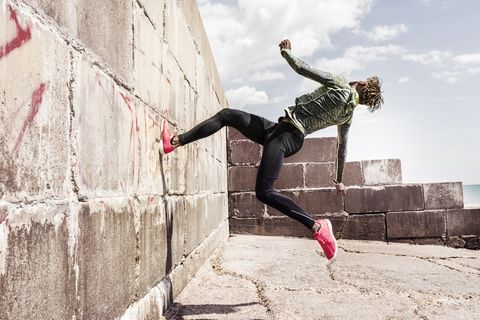 Man running up wall