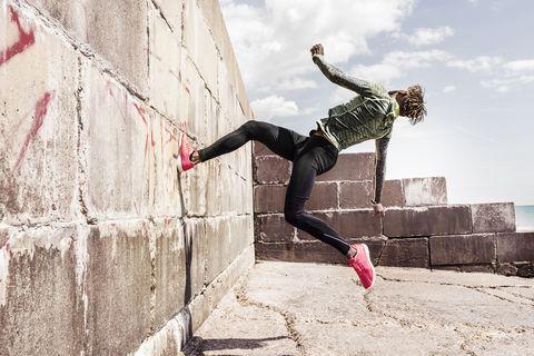 Man running up wall