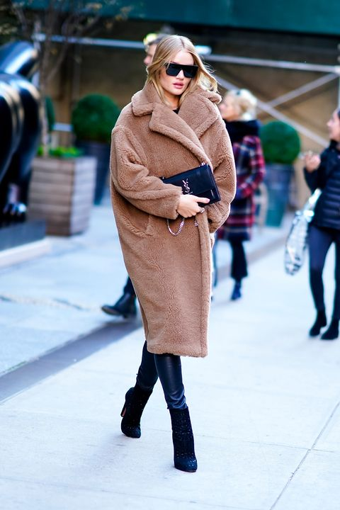 Clothing, Street fashion, Fashion, Fur, Coat, Outerwear, Knee, Footwear, Overcoat, Snapshot,