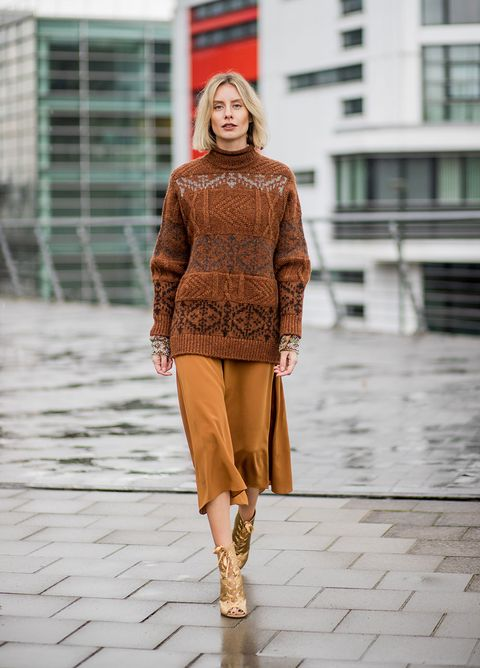Fashion model, Fashion, Clothing, Street fashion, Orange, Fashion show, Runway, Brown, Footwear, Yellow,