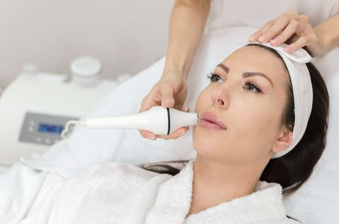 Woman during hyaluron in lips, face and skin treatment