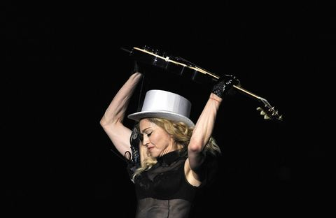 Photography, Headgear, Hand, Performance, Flash photography, Musical instrument, Hat,