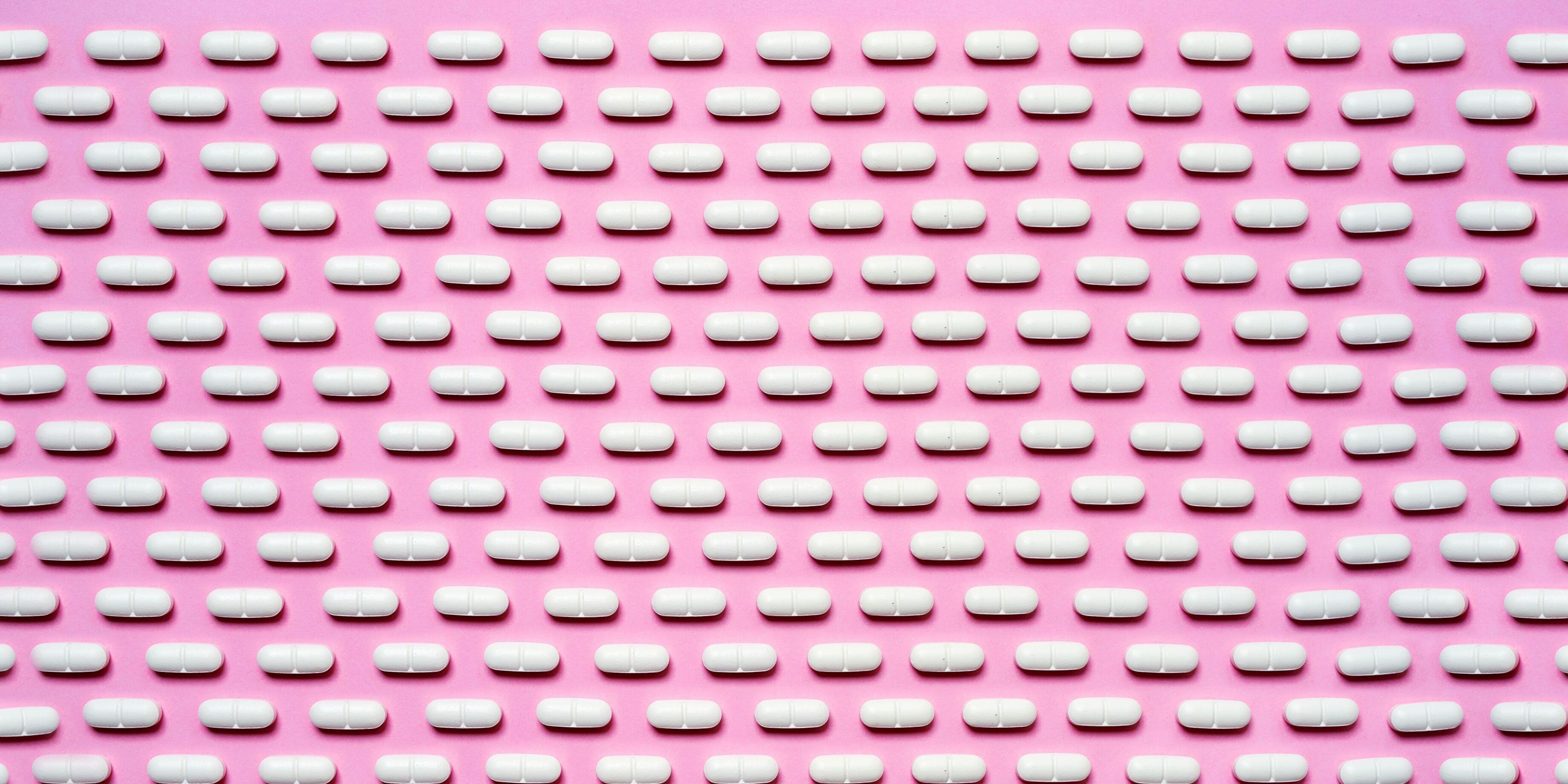 Full Frame Shot Of Pills Arranged On Pink Background