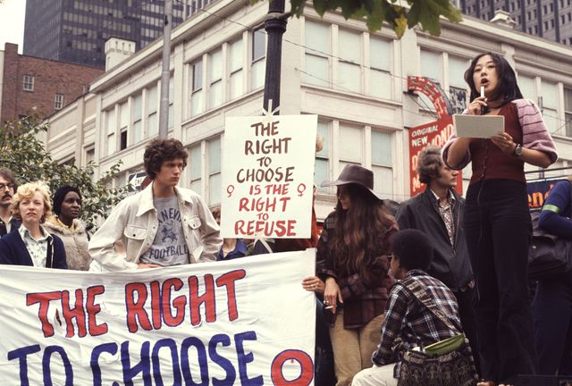 asian woman speaker atreproductive rights demonstration, pittsburgh, pa, 1974