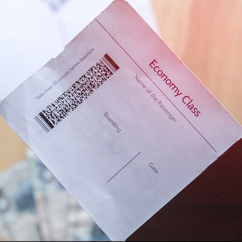 Flight booking ticket with a part of Passaport