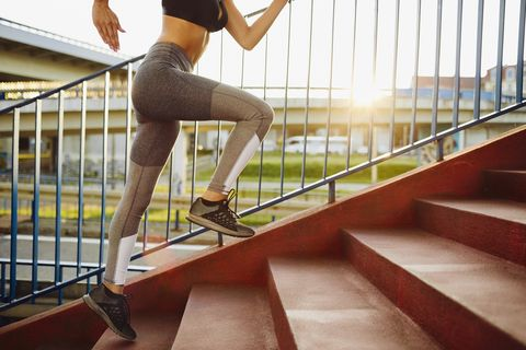 Woman running on stairs in the city
