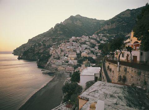 Coast, Town, Sky, Sea, Promontory, Village, Water, Tourism, Mountain, Coastal and oceanic landforms,