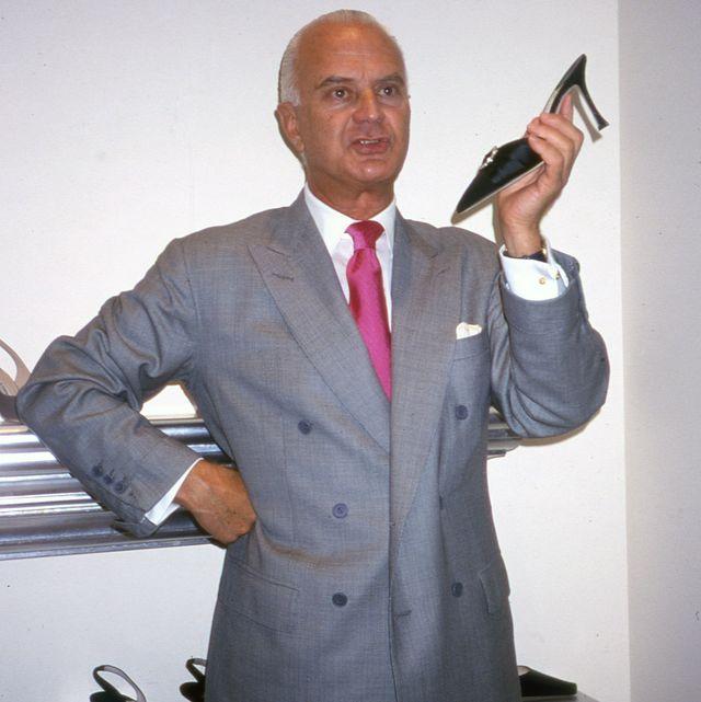 Manolo Blahnik in his New York boutique, '80s