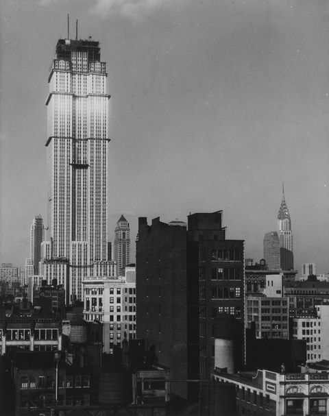 Empire State Building under construction with the Chrysler Building in the background, 1930.