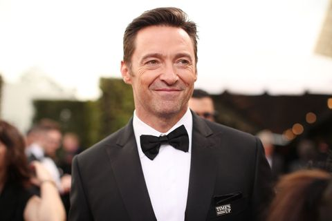 Suit, Facial expression, Formal wear, Tuxedo, Hairstyle, White-collar worker, Forehead, Fashion, Smile, Tie,