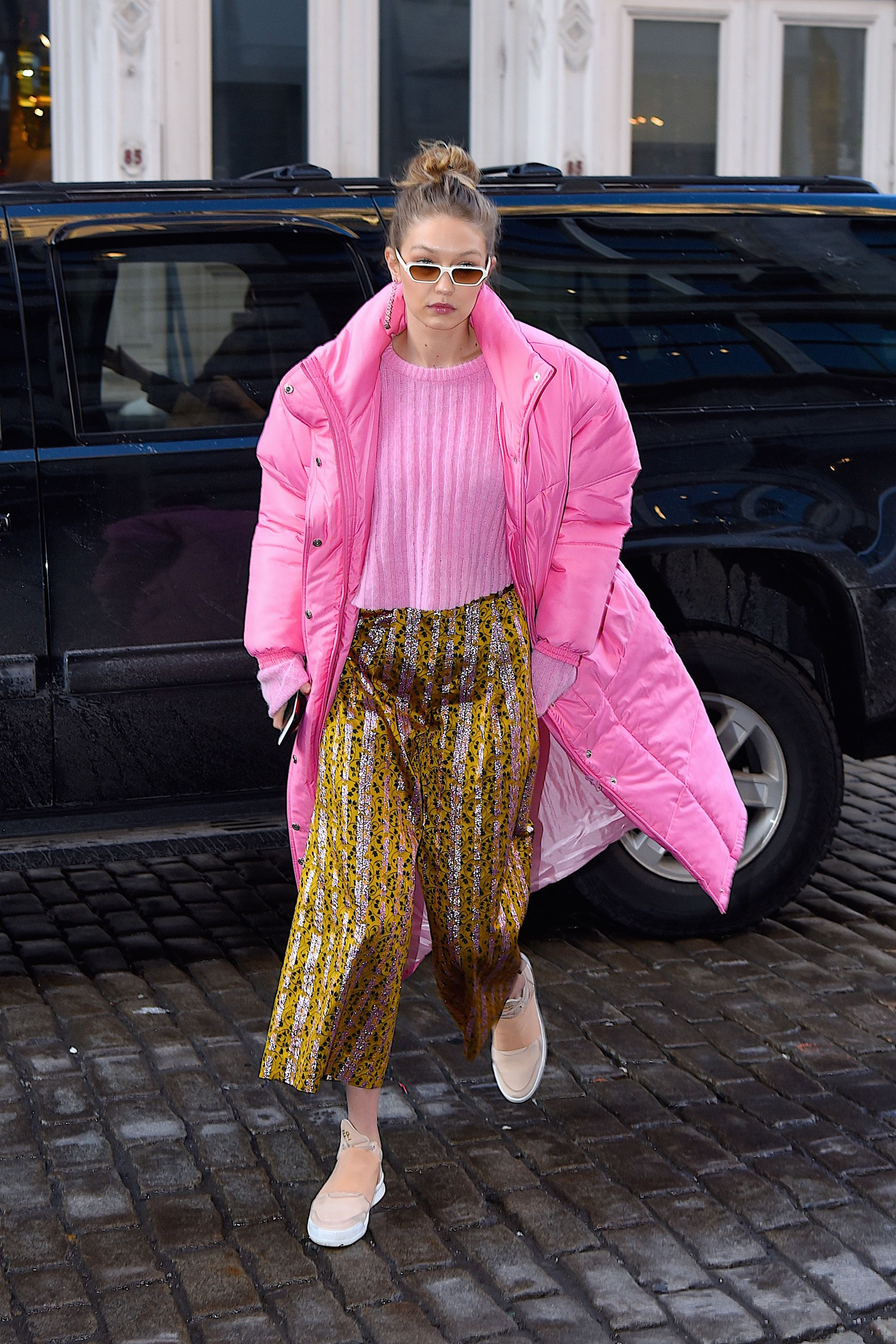 January 9, 2018 Hadid practically stopped traffic in her pink  puffer coat by Christina Ledang. She wore it with an equally pink ribbed shirt from the designer and a pair of sparkly pants from Christopher Bu.