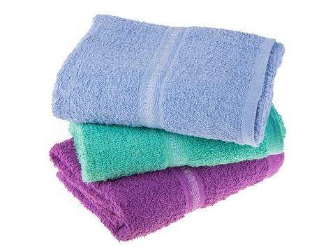 Close-Up Of Multi Colored Towels Over White Background
