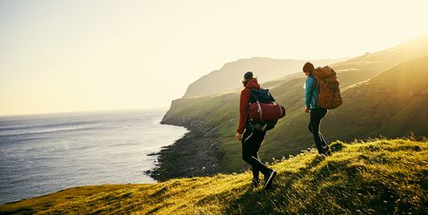 People in nature, Photograph, Sky, Water, Atmospheric phenomenon, Mountain, Coast, Horizon, Sea, Adventure,