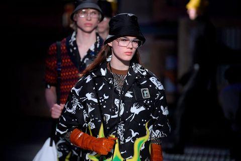 Fashion, Street fashion, Headgear, Event, Photography, Night, Hat, Performance, Fashion accessory, Fashion design,