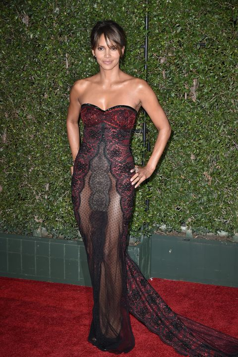Clothing, Dress, Carpet, Gown, Red carpet, Hairstyle, Strapless dress, Flooring, Fashion, Long hair,
