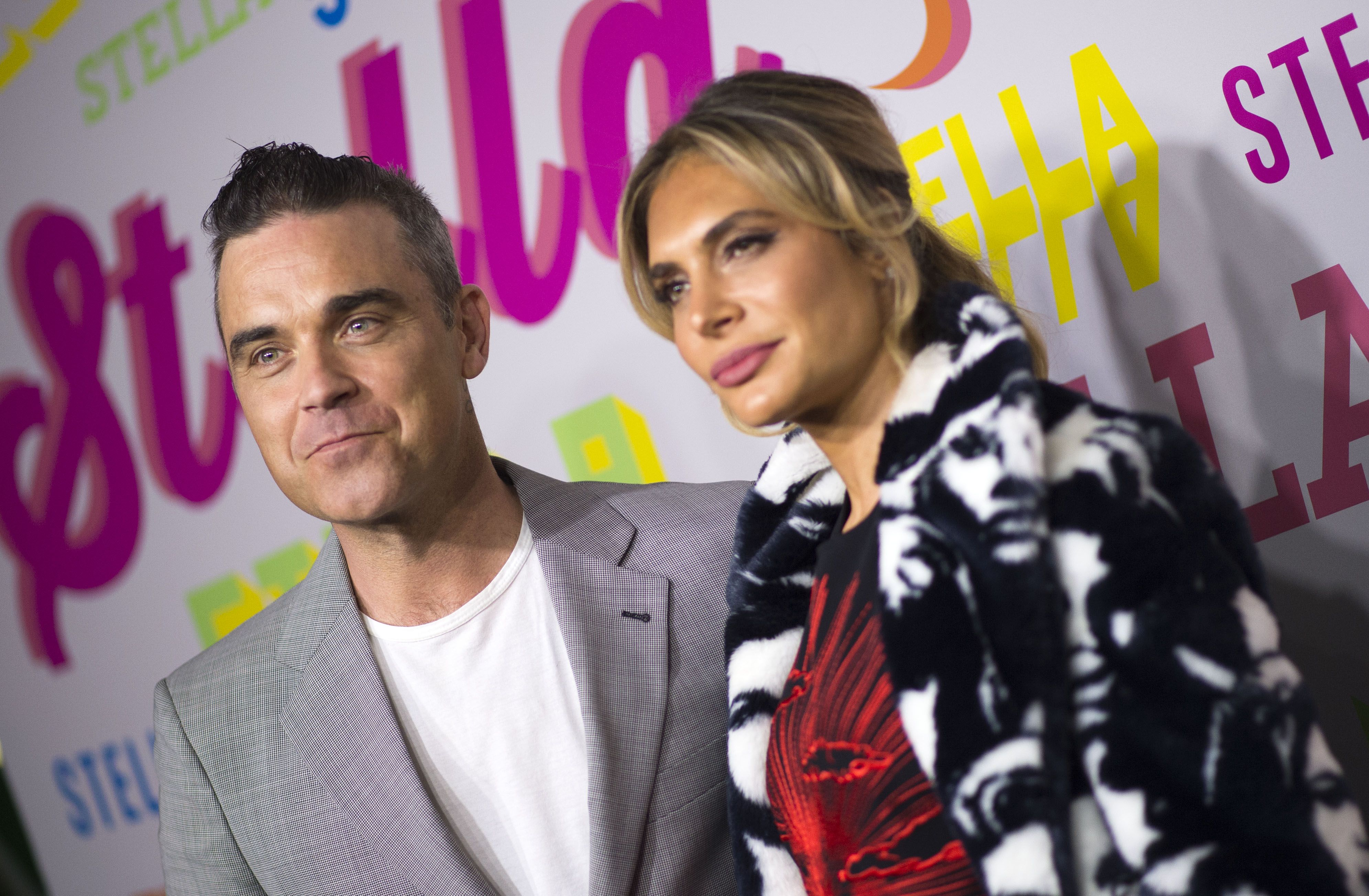 Simon Cowell says Robbie Williams and his wife are joining the X Factor judging panel
