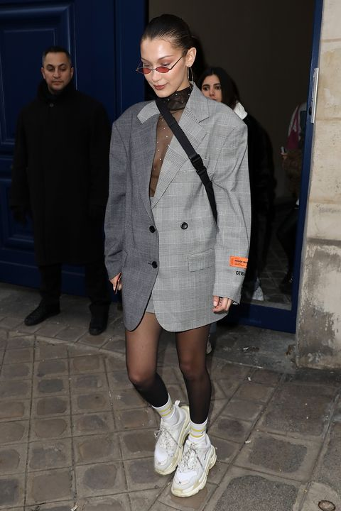 8ec304422e3 Bella Hadid in January 2018 wearing Balenciaga sneakers during Paris  Fashion Week.