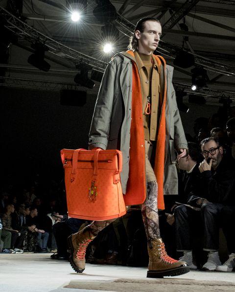 Fashion, Runway, Fashion show, Fashion model, Orange, Fashion design, Event, Public event, Outerwear, Model,