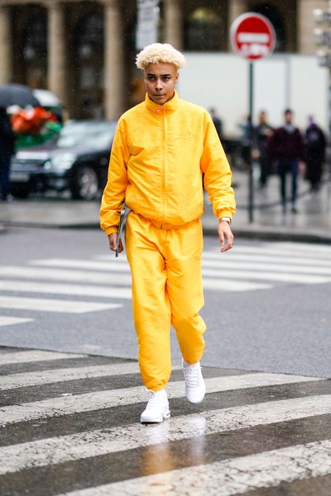 Yellow, Orange, Street fashion, Road, Fashion, Outerwear, Infrastructure, Street, Pedestrian, Asphalt,