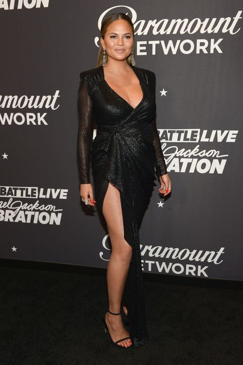 Clothing, Dress, Shoulder, Fashion model, Little black dress, Cocktail dress, Fashion, Hairstyle, Joint, Footwear,