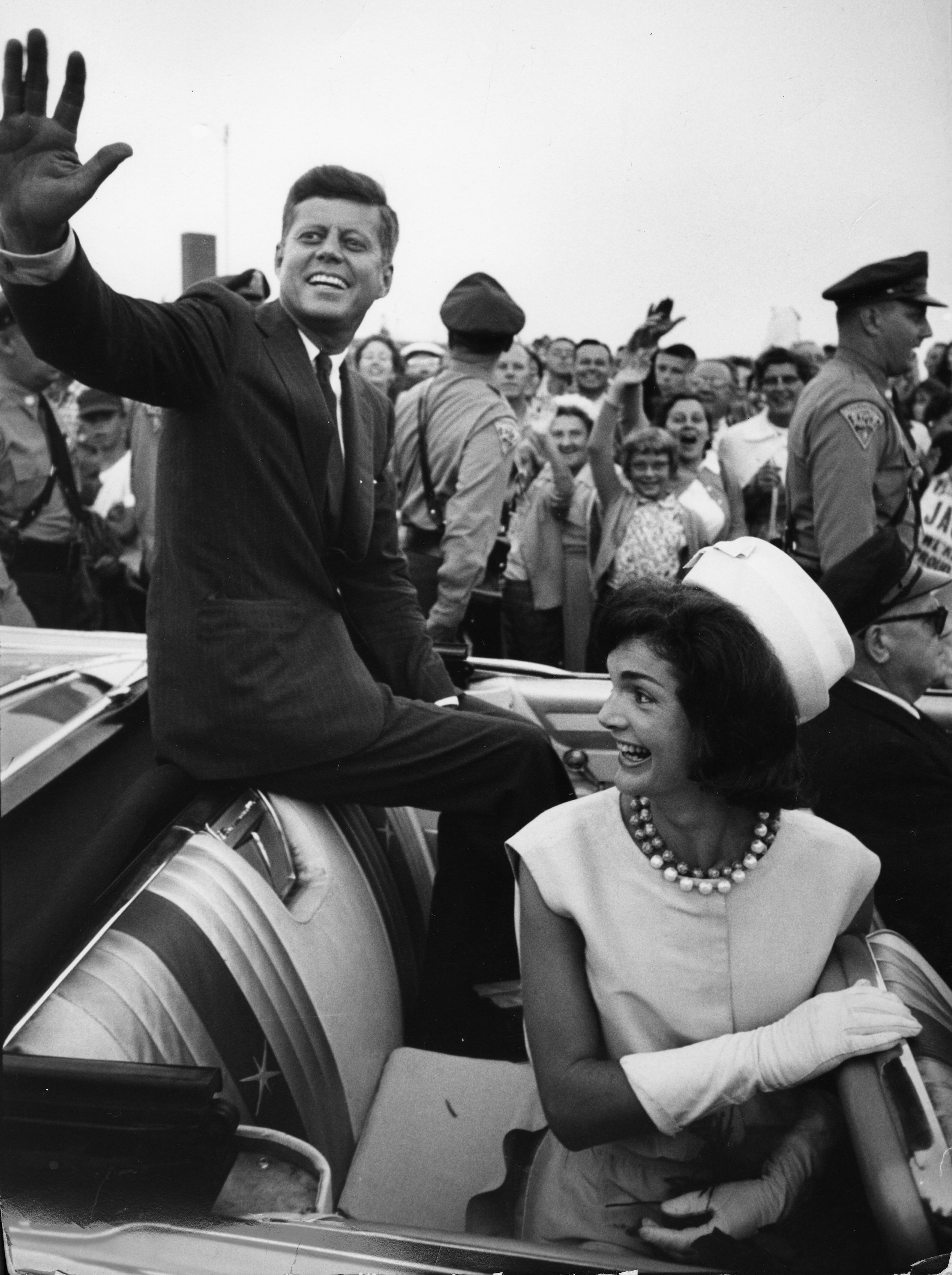 Jackie and her husband wave to crowds in Massachusetts during the beginning of his presidential campaign.