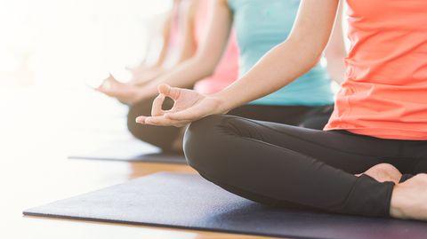 Low Section Of Women Exercising In Yoga Studio