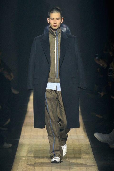 Fashion, Runway, Fashion show, Fashion design, Fashion model, Outerwear, Darkness, Event, Model, Suit,