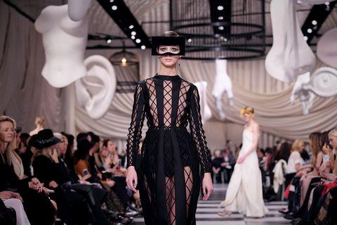 Fashion, Fashion model, Runway, Haute couture, Fashion show, Event, Fashion design, Dress, Performance, Gothic fashion,