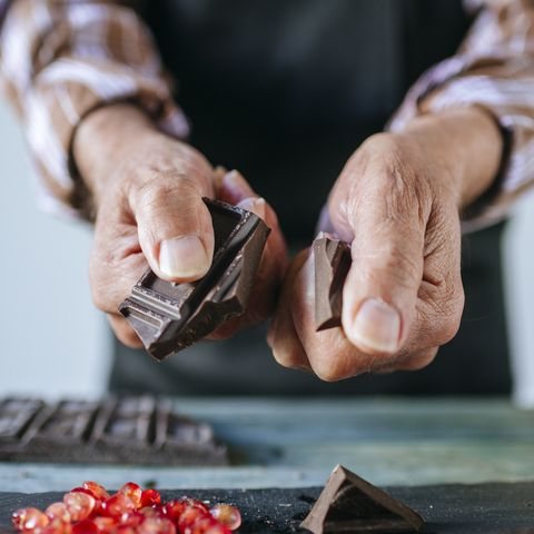 Man's hands breaking a chocolate bar, close-up