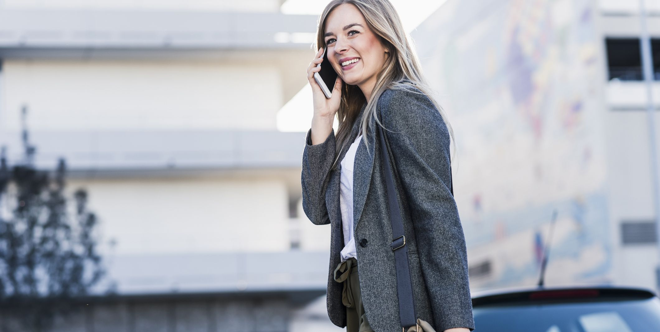 Happy young woman on cell phone in the city