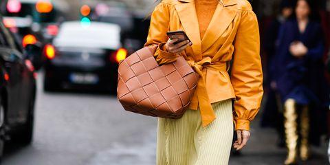 Street fashion, Orange, Fashion, Yellow, Human, Outerwear, Fashion accessory, Bag, Street, Style,