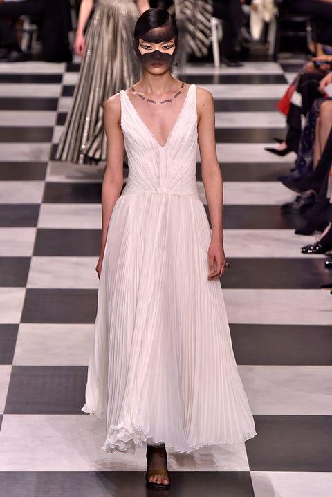 Fashion model, Fashion, Clothing, Dress, White, Haute couture, Gown, Shoulder, Runway, Fashion show,