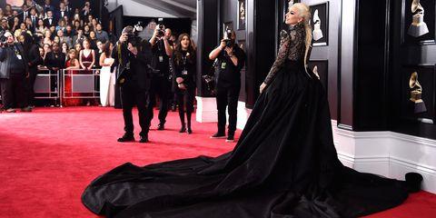 Red carpet, Carpet, Dress, Clothing, Flooring, Fashion, Premiere, Gown, Haute couture, Shoulder,