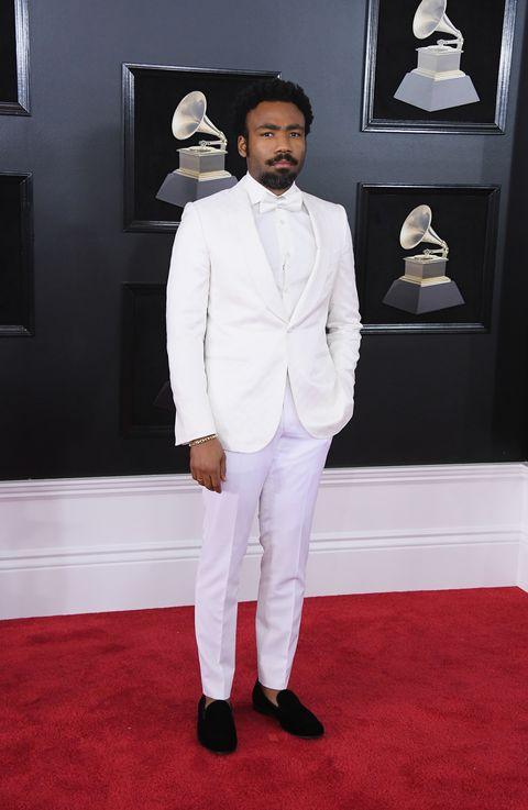 Suit, White, Red carpet, Formal wear, Clothing, Carpet, Tuxedo, Fashion, Flooring, Blazer,
