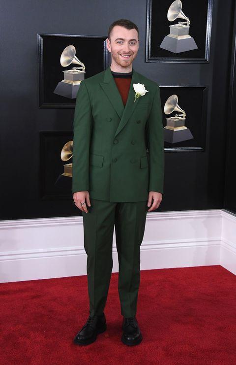 Suit, Red carpet, Carpet, Formal wear, Clothing, Tuxedo, Flooring, Outerwear, Pantsuit, Blazer,