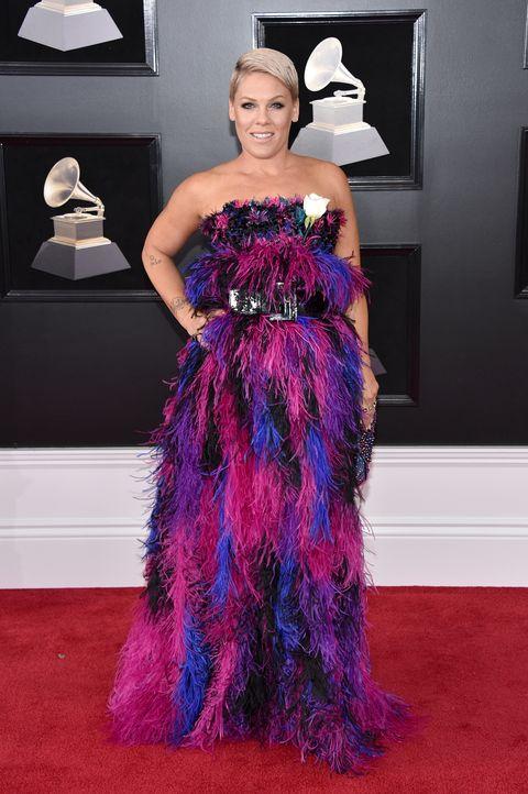 Red carpet, Carpet, Dress, Clothing, Shoulder, Purple, Haute couture, Fashion, Gown, Flooring,