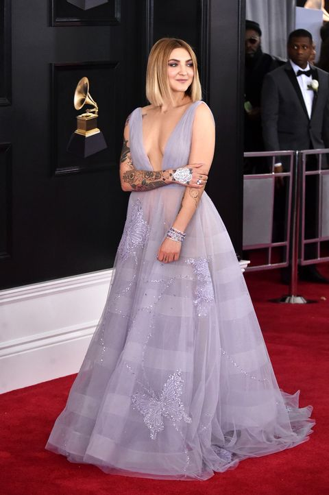 Gown, Red carpet, Carpet, Dress, Clothing, Flooring, Shoulder, Fashion model, Premiere, Hairstyle,