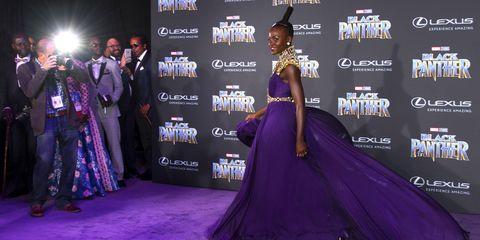 Gown, Carpet, Purple, Dress, Clothing, Red carpet, Fashion, Violet, Formal wear, Flooring,