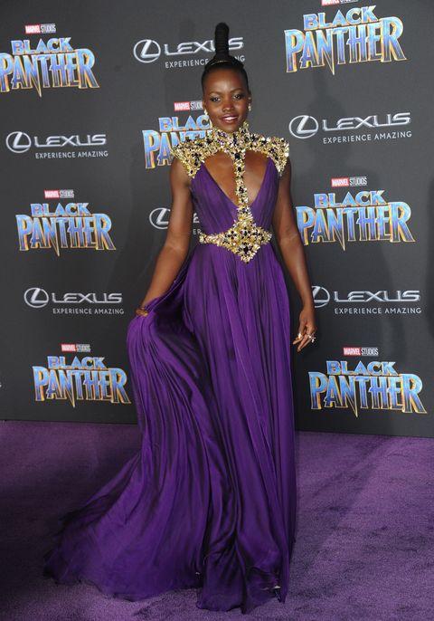 Purple, Dress, Clothing, Gown, Formal wear, Premiere, Fashion, Shoulder, Carpet, Event,