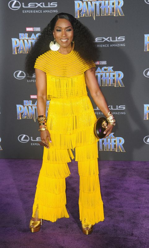Clothing, Yellow, Red carpet, Premiere, Carpet, Shoulder, Flooring, Dress, Event, Long hair,