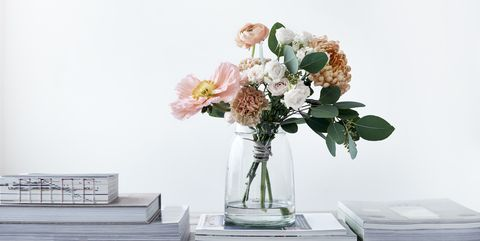 bouquet of poppies ranunculus eucalyptus chrysanthemums roses carnations