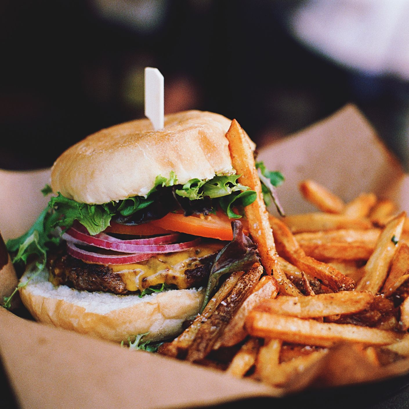 Close-Up Of Burger With French Fries On Table