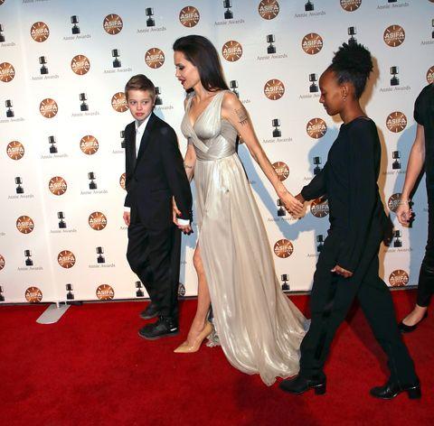 Red carpet, Carpet, Flooring, Dress, Formal wear, Event, Premiere, Fashion, Suit, Tuxedo,