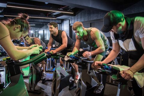 Indoor cycling, Green, Room, Muscle, Event, Leisure, Vehicle, Exercise, Recreation, Bicycle,